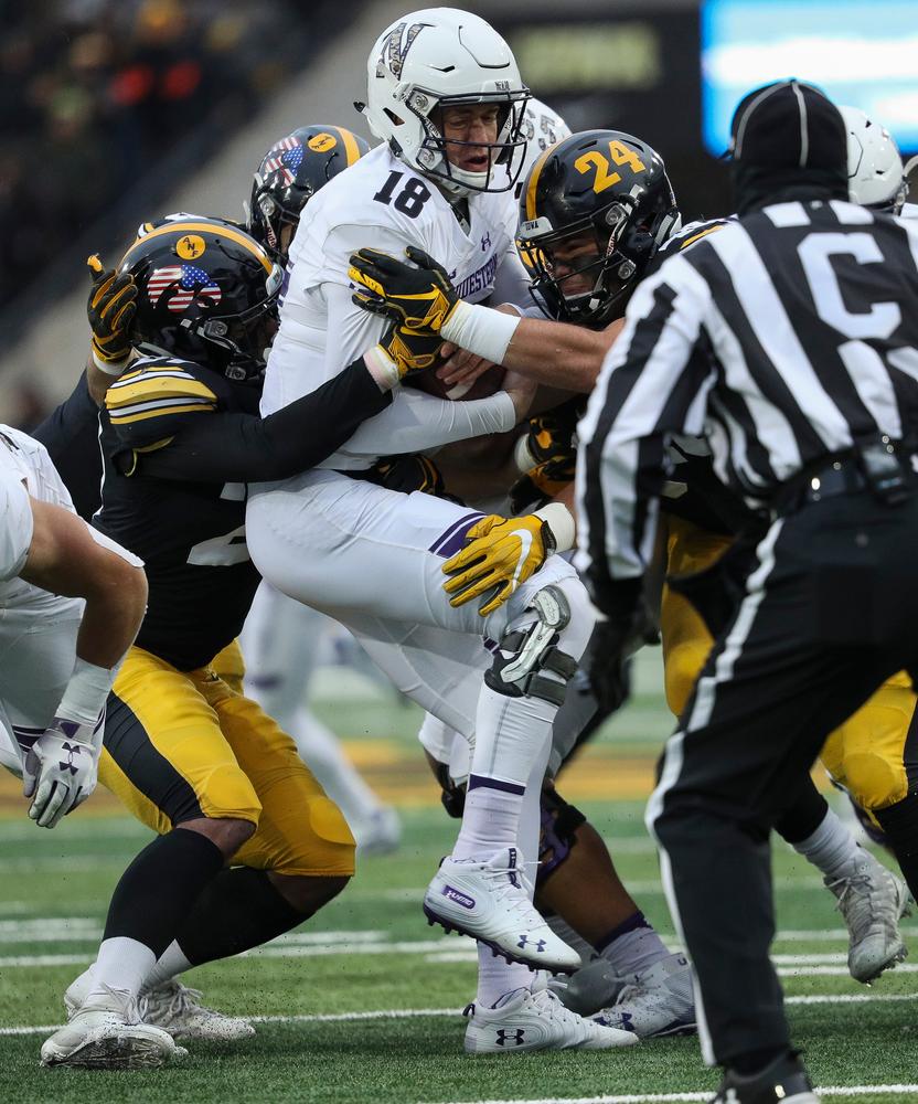Iowa Hawkeyes defensive back Amani Hooker (27) and Iowa Hawkeyes linebacker Jack Hockaday (48) sack the quarterback during a game against Northwestern at Kinnick Stadium on November 10, 2018. (Tork Mason/hawkeyesports.com)