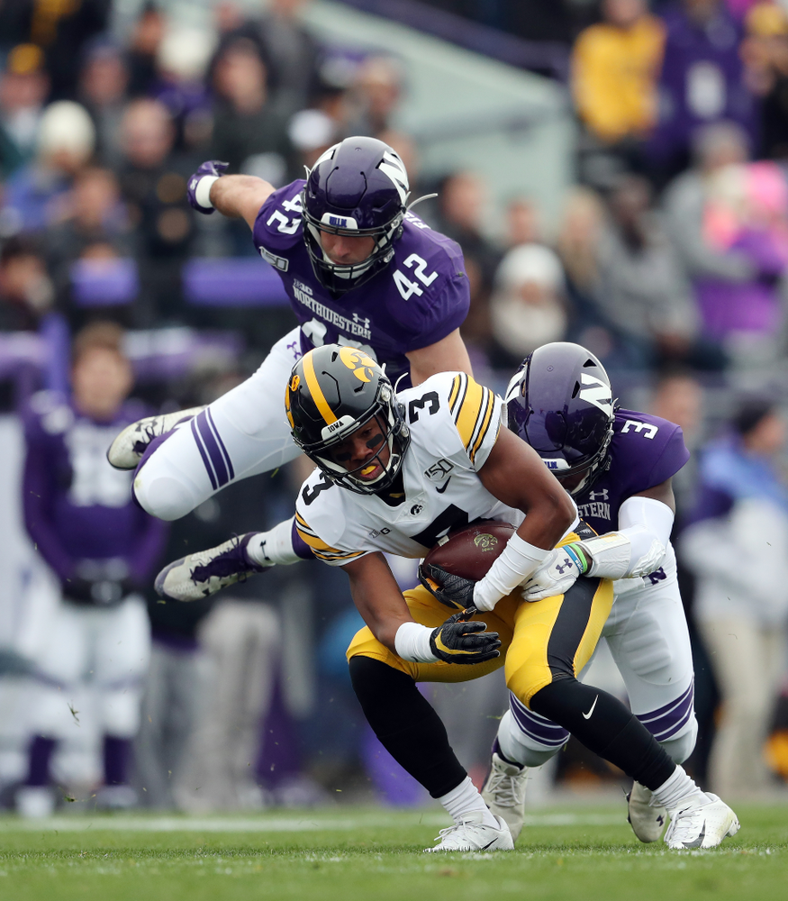 Iowa Hawkeyes wide receiver Tyrone Tracy Jr. (3) spins out of a tackle on his way to a touchdown against the Northwestern Wildcats Saturday, October 26, 2019 at Ryan Field in Evanston, Ill. (Brian Ray/hawkeyesports.com)