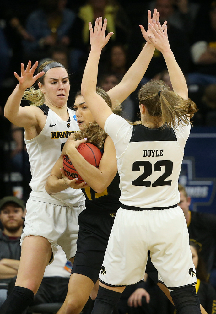 Iowa Hawkeyes forward Hannah Stewart (21) and guard Kathleen Doyle (22) pressure Missouri Tigers forward Hannah Schuchts (13) which led to a turnover during the first quarter of their second round game in the 2019 NCAA Women's Basketball Tournament at Carver Hawkeye Arena in Iowa City on Sunday, Mar. 24, 2019. (Stephen Mally for hawkeyesports.com)