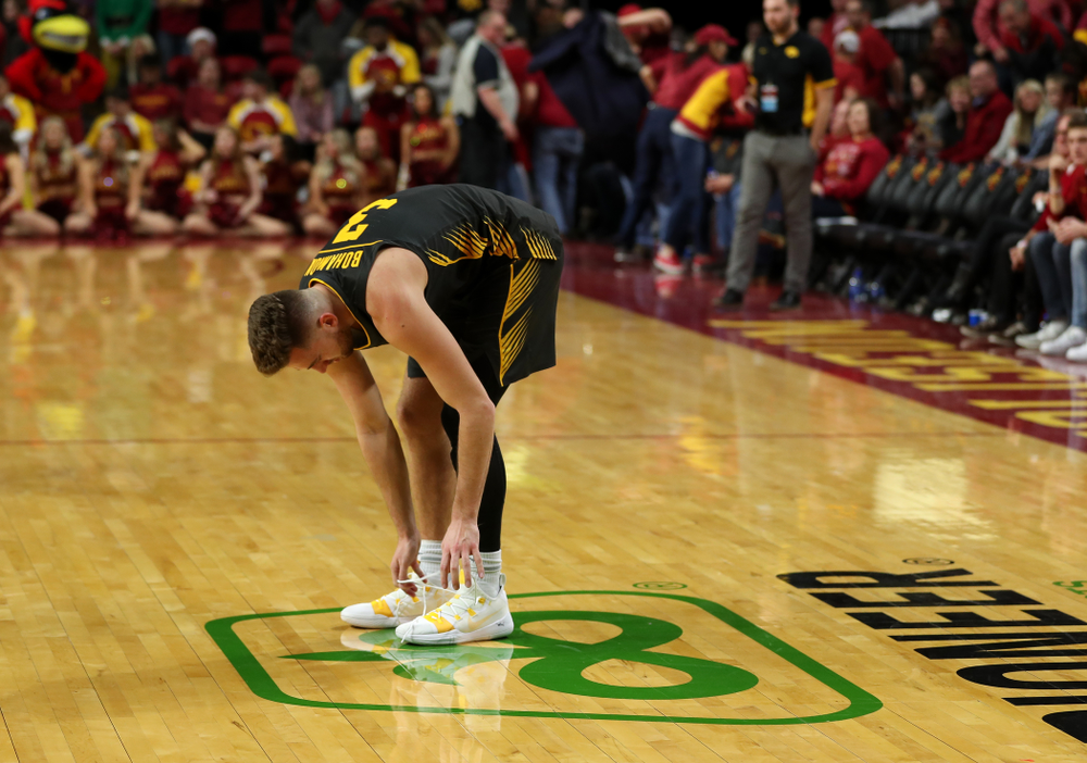 Iowa Hawkeyes guard Jordan Bohannon (3) unties his shoes following their game against the Iowa State Cyclones Thursday, December 12, 2019 at Hilton Coliseum in Ames, Iowa(Brian Ray/hawkeyesports.com)