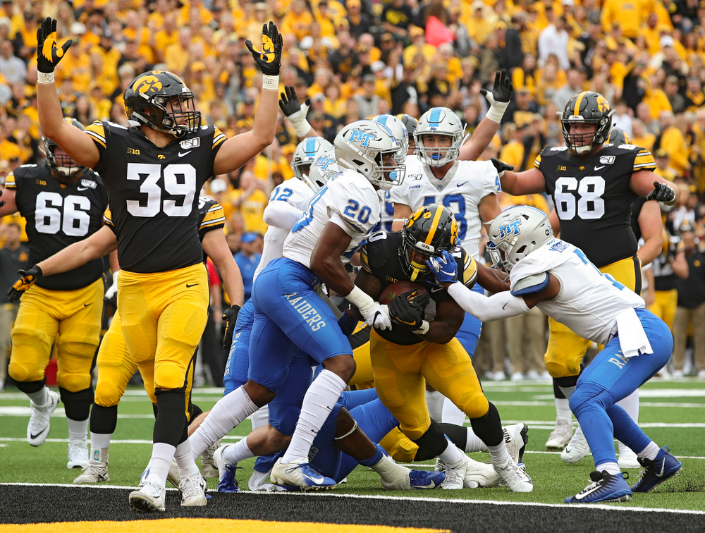 Iowa Hawkeyes running back Mekhi Sargent (10) scores a touchdown on a 4-yard run as tight end Nate Wieting (39) raises his arms during the first quarter of their game at Kinnick Stadium in Iowa City on Saturday, Sep 28, 2019. (Stephen Mally/hawkeyesports.com)
