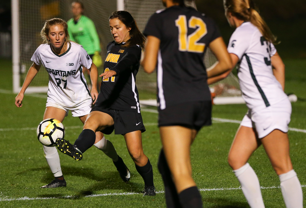 Iowa Hawkeyes forward Emma Tokuyama (21) passes the ball during a game against Michigan State at the Iowa Soccer Complex on October 12, 2018. (Tork Mason/hawkeyesports.com)