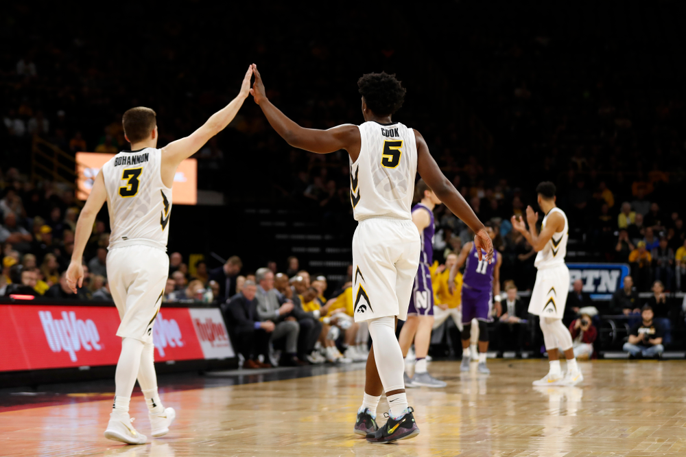 Iowa Hawkeyes guard Jordan Bohannon (3) and forward Tyler Cook (5)