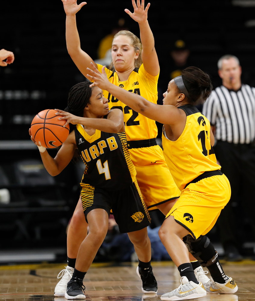 Iowa Hawkeyes guard Kathleen Doyle (22) and guard Tania Davis (11)