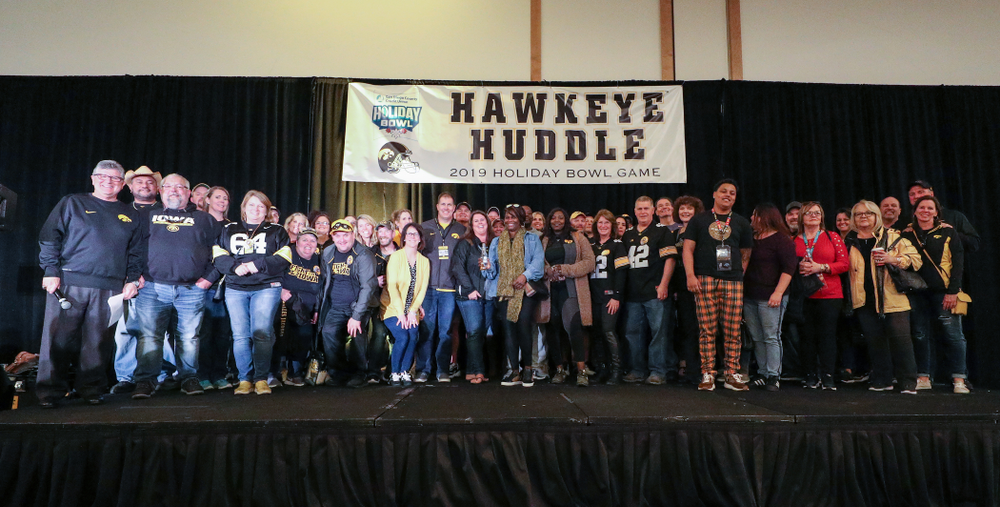 Parents and relatives of members of the Hawkeye Football team stand on stage during the Holiday Bowl Hawkeye Huddle Thursday, December 26, 2019 at the Hilton in downtown San Diego. (Brian Ray/hawkeyesports.com)