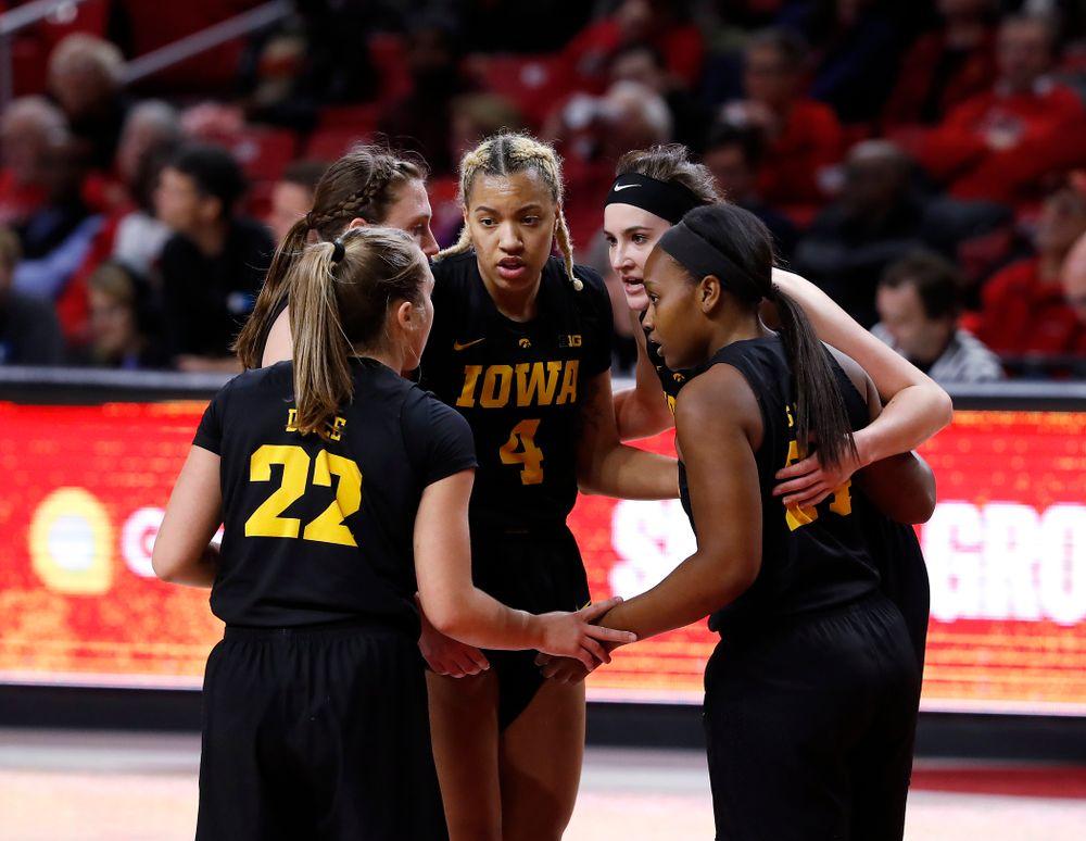 Iowa Hawkeyes forward Chase Coley (4) and forward Megan Gustafson (10)