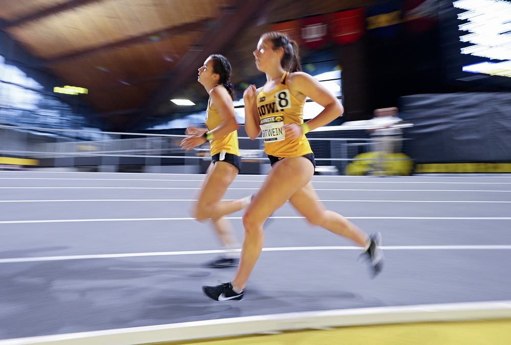 Iowa's Wren Renquist (from left) and Maggie Gutwein run the women's 3000 meter run event during the Hawkeye Invitational at the Recreation Building in Iowa City on Saturday, January 11, 2020. (Stephen Mally/hawkeyesports.com)