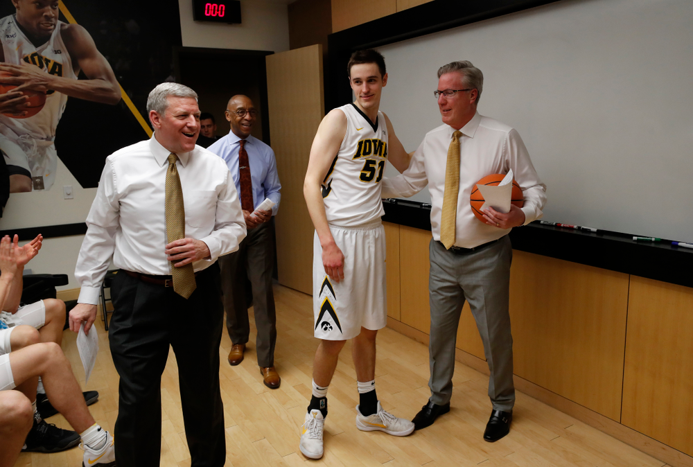 Iowa Hawkeyes forward Nicholas Baer (51) and head coach Fran McCaffery