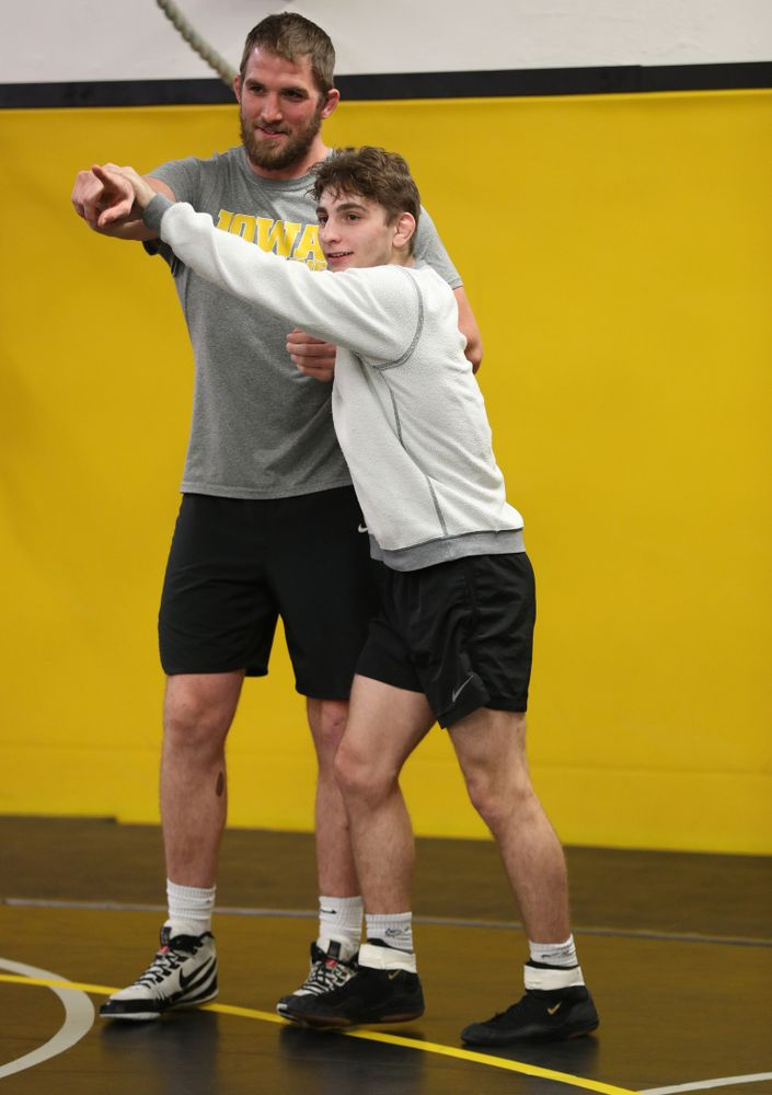 Iowa Hawkeyes 133 pounder Austin DeSanto messes around with former heavyweight Bobby Telford during the team's annual media day Monday, November 5, 2018 at Carver-Hawkeye Arena. (Brian Ray/hawkeyesports.com)
