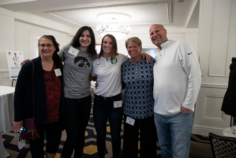 Iowa Hawkeyes forward Megan Gustafson (10), OregonÕs Sabrina Ionescu, and WNBA Legend Ann Meyers Drysdale  during the Wooden Award DukeÕs Dinner Thursday, April 11, 2019 at the LA Athletic Club. (Brian Ray/hawkeyesports.com)