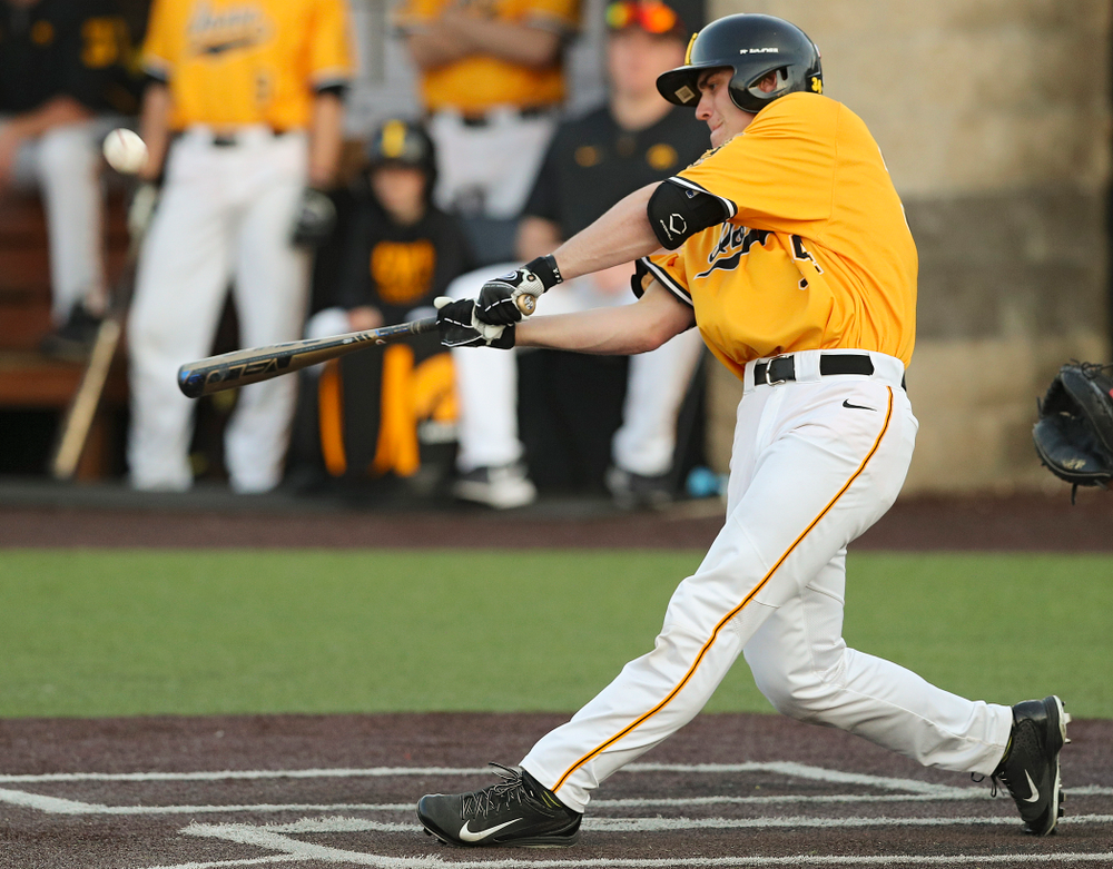 Iowa Hawkeyes designated hitter Austin Martin (34) hits an RBI single during the eighth inning of their game against Northern Illinois at Duane Banks Field in Iowa City on Tuesday, Apr. 16, 2019. (Stephen Mally/hawkeyesports.com)