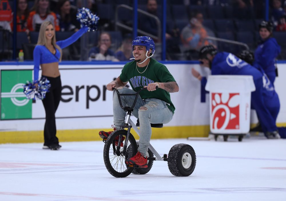 Iowa Hawkeyes defensive back Amani Hooker (27) rides a tricycle during a contest against Mississippi State in the first intermission of the Tampa Bay Lightning game Thursday, December 27, 2018 at Amalie Arena. (Brian Ray/hawkeyesports.com)