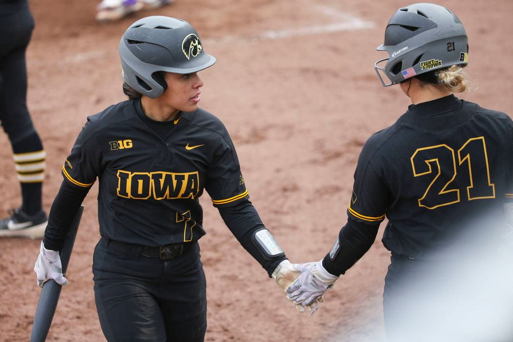 Iowa outfielder Lea Thompson (7) and Iowa's Havyn Monteer (21) at game 2 vs Northwestern on Saturday, March 30, 2019 at Bob Pearl Field. (Lily Smith/hawkeyesports.com)