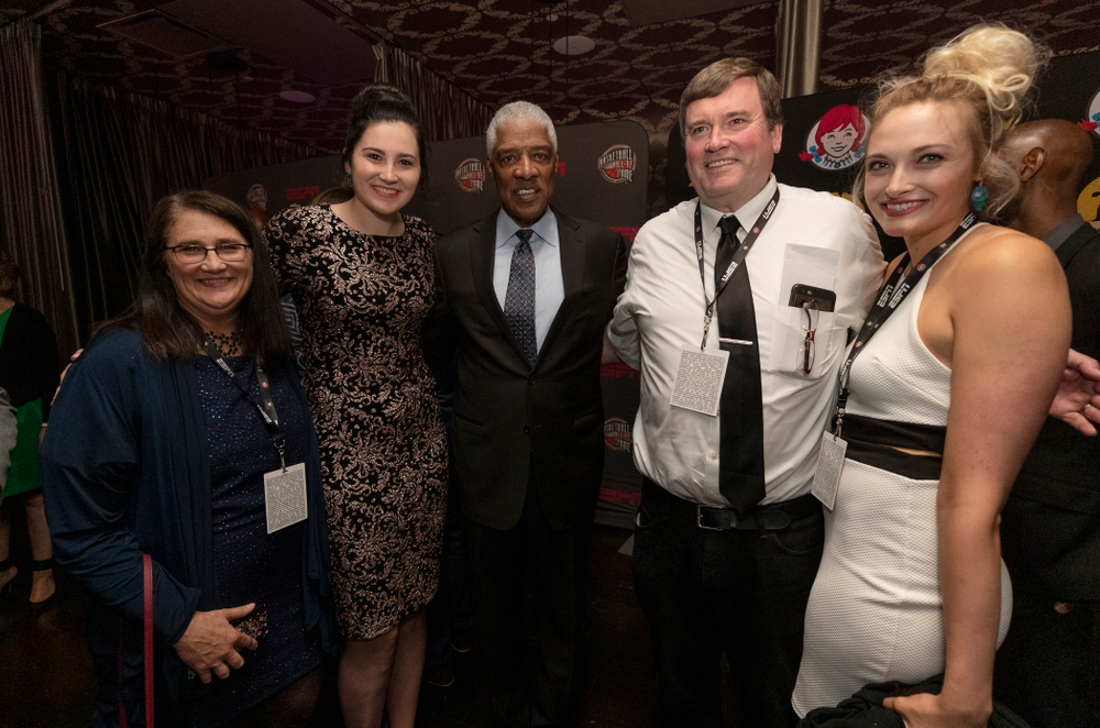 Iowa Hawkeyes forward Megan Gustafson (10) and her family with NBA great Julius Erving before the ESPN College Basketball Awards show Friday, April 12, 2019 at The Novo at LA Live.  (Brian Ray/hawkeyesports.com)