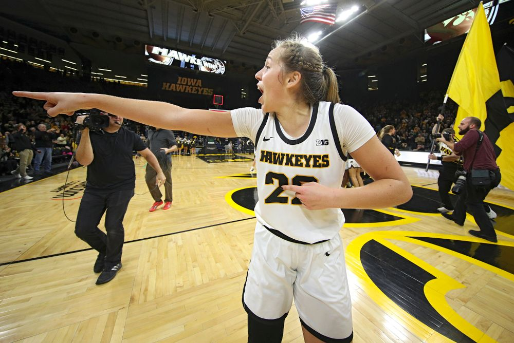 Iowa Hawkeyes guard Kathleen Doyle (22) points to the crowd as she celebrates after their double overtime win at Carver-Hawkeye Arena in Iowa City on Sunday, January 12, 2020. (Stephen Mally/hawkeyesports.com)