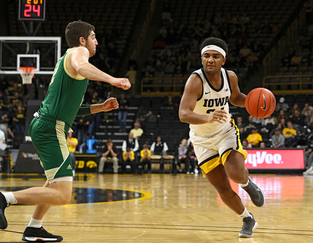 Iowa Hawkeyes guard Nicolas Hobbs (24) drives with the ball during the second half of their game at Carver-Hawkeye Arena in Iowa City on Sunday, Nov 24, 2019. (Stephen Mally/hawkeyesports.com)