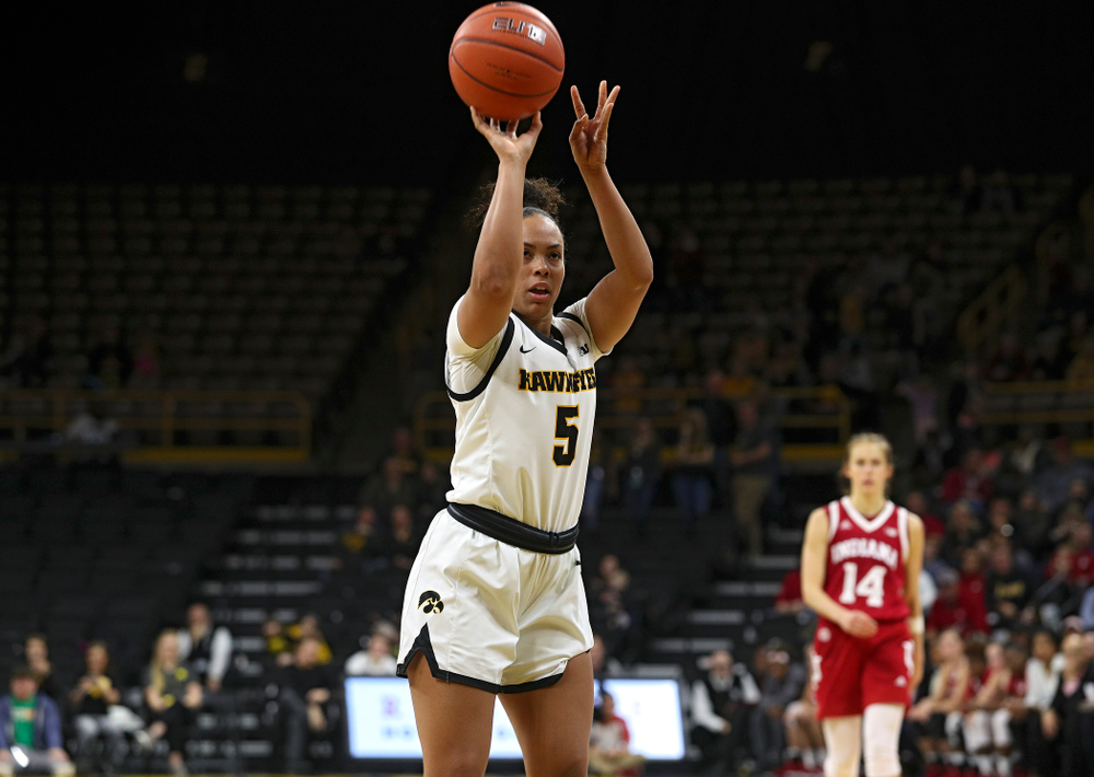 Iowa Hawkeyes guard Alexis Sevillian (5) makes a free throw during the second overtime period of their game at Carver-Hawkeye Arena in Iowa City on Sunday, January 12, 2020. (Stephen Mally/hawkeyesports.com)