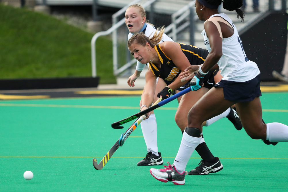 Iowa Hawkeyes midfielder Sophie Sunderland (20) takes a shot during a game against No. 6 Penn State at Grant Field on October 12, 2018. (Tork Mason/hawkeyesports.com)
