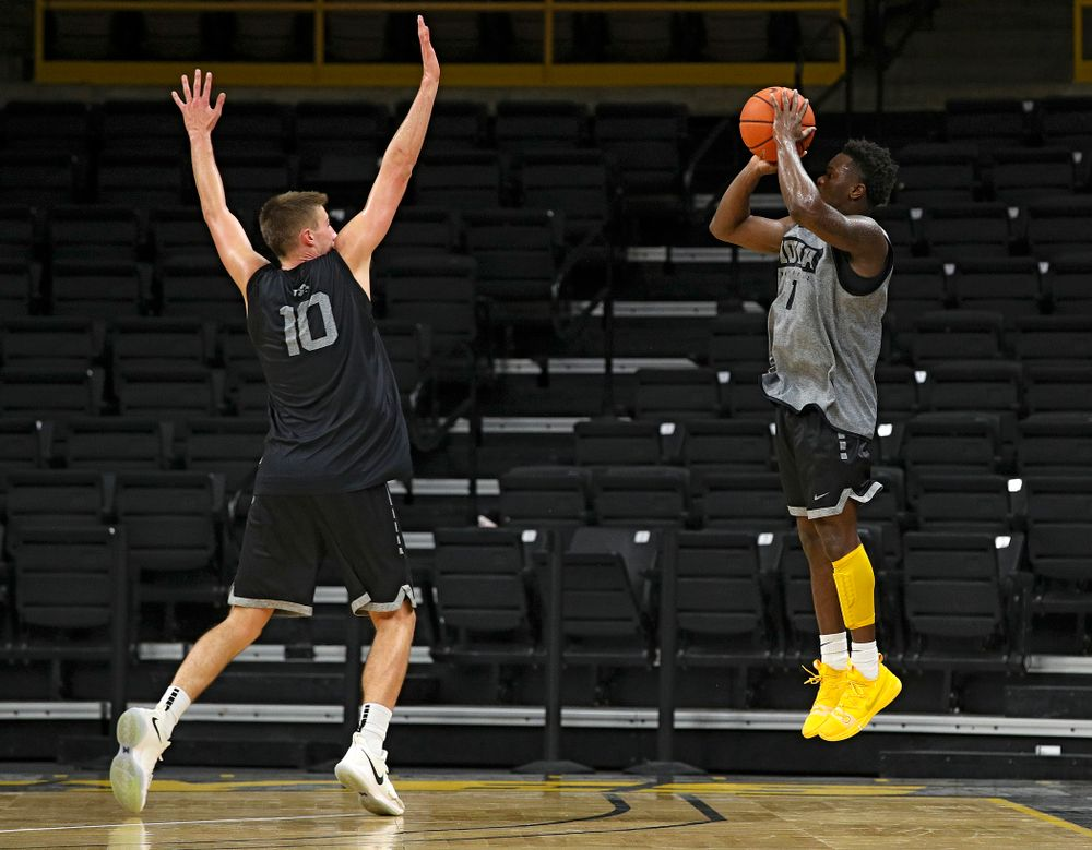 Iowa Hawkeyes guard Joe Toussaint (1) puts up a shot over the hand of guard Joe Wieskamp (10) during practice at Carver-Hawkeye Arena in Iowa City on Monday, Sep 30, 2019. (Stephen Mally/hawkeyesports.com)