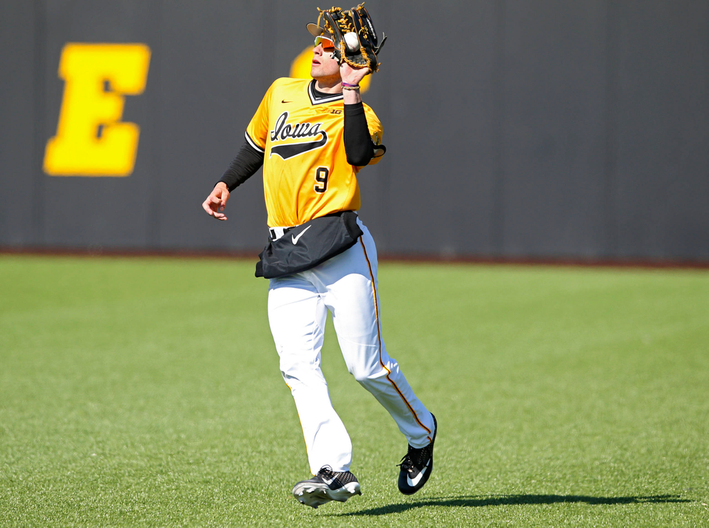 Iowa Hawkeyes right fielder Ben Norman (9) pulls in the ball for an out during the ninth inning against Illinois at Duane Banks Field in Iowa City on Sunday, Mar. 31, 2019. (Stephen Mally/hawkeyesports.com)