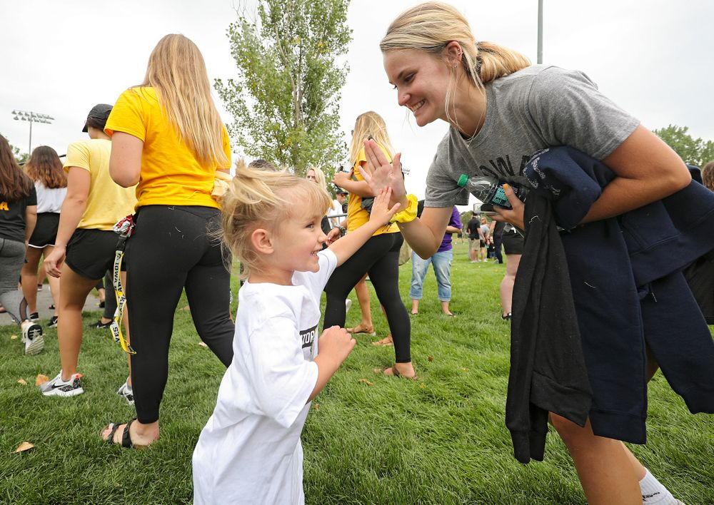 A young fan greets student-athletes in the Parade of Champions during the Student-Athlete Kickoff at the Iowa Soccer Complex in Iowa City on Sunday, Aug 25, 2019. (Stephen Mally/hawkeyesports.com)