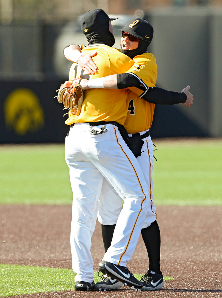 Iowa Hawkeyes shortstop Tanner Wetrich (16) and second baseman Mitchell Boe (4) celebrate after winning their game against Illinois at Duane Banks Field in Iowa City on Sunday, Mar. 31, 2019. (Stephen Mally/hawkeyesports.com)
