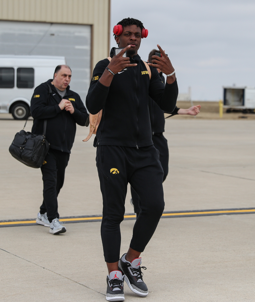 Iowa Hawkeyes forward Tyler Cook (25) boards a flight to Columbus for the first and second rounds of the 2019 NCAA Men's Basketball Tournament Wednesday, March 20, 2019 at the Eastern Iowa Airport. (Brian Ray/hawkeyesports.com)