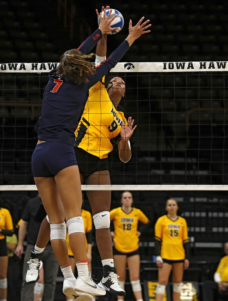 Iowa's Amiya Jones (9) gets a kill during the third set of their match against Illinois at Carver-Hawkeye Arena in Iowa City on Wednesday, Nov 6, 2019. (Stephen Mally/hawkeyesports.com)