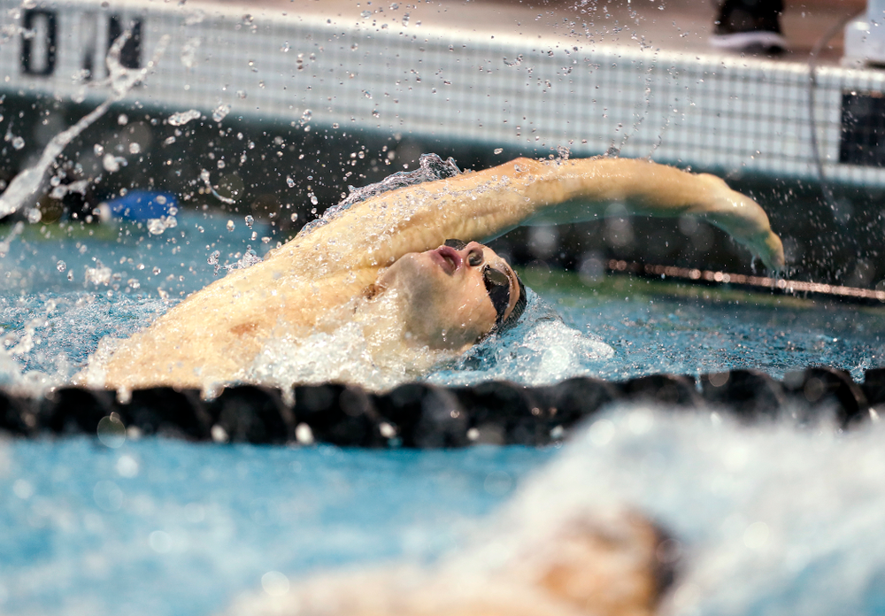 Iowa's Kenneth Mende swims the 100 yard backstroke