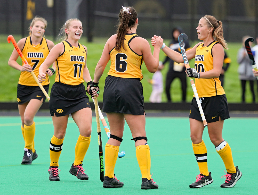 Iowa's Anthe Nijziel (6) celebrates with Katie Birch (11) and Sophie Sunderland (20) after Nijziel scored a goal during the third quarter of their game against UC Davis at Grant Field in Iowa City on Sunday, Oct 6, 2019. (Stephen Mally/hawkeyesports.com)