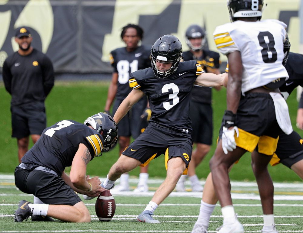 Iowa Hawkeyes place kicker Keith Duncan (3) makes a field goal from the hold of Colten Rastetter (7) during Fall Camp Practice No. 15 at the Hansen Football Performance Center in Iowa City on Monday, Aug 19, 2019. (Stephen Mally/hawkeyesports.com)