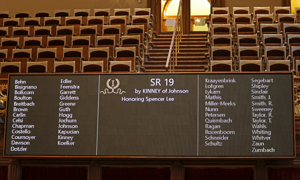 The board displays Senate Resolution 19 to honor Iowa's Spencer Lee in the Senate Chamber at the Iowa State Capitol Building on Tuesday, Apr. 9, 2019. (Stephen Mally/hawkeyesports.com)