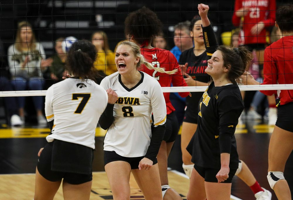 Iowa Hawkeyes right side hitter Reghan Coyle (8) celebrates after winning a point during a match against Maryland at Carver-Hawkeye Arena on November 23, 2018. (Tork Mason/hawkeyesports.com)