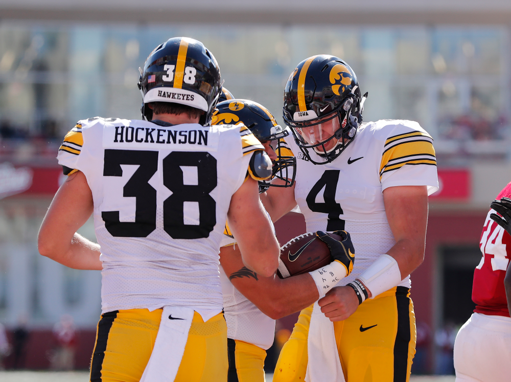 Iowa Hawkeyes fullback Austin Kelly celebrates with quarterback Nate Stanley (4) after scoring  against the Indiana Hoosiers Saturday, October 13, 2018 at Memorial Stadium, in Bloomington, Ind. (Brian Ray/hawkeyesports.com)