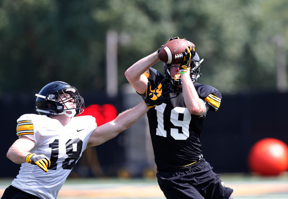 Iowa Hawkeyes wide receiver Max Cooper (19) and defensive back John Milani (18) during practice No. 7 of fall camp Friday, August 10, 2018 at the Kenyon Football Practice Facility. (Brian Ray/hawkeyesports.com)
