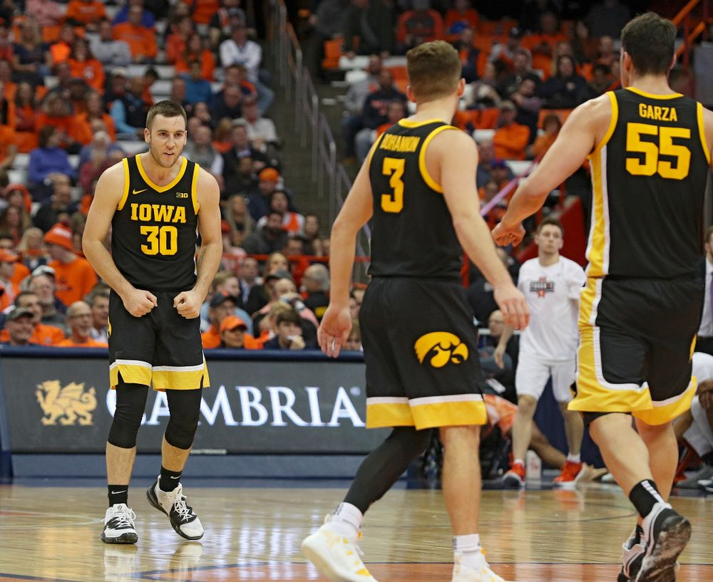 Iowa Hawkeyes guard Connor McCaffery (30) is pumped up as he walks to his team's bench for a timeout after making a 3-pointer during the second half of their ACC/Big Ten Challenge game at the Carrier Dome in Syracuse, N.Y. on Tuesday, Dec 3, 2019. (Stephen Mally/hawkeyesports.com)