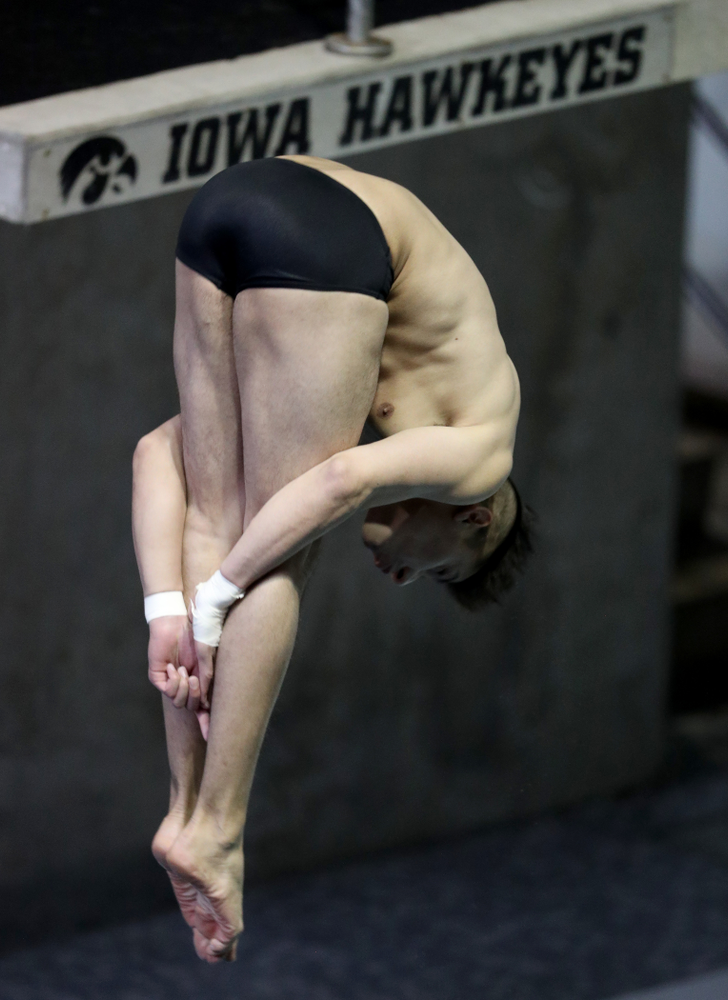 IowaÕs Jonatan Posligua competes on the 1 meter springboard against Notre Dame and Illinois Saturday, January 11, 2020 at the Campus Recreation and Wellness Center.  (Brian Ray/hawkeyesports.com)