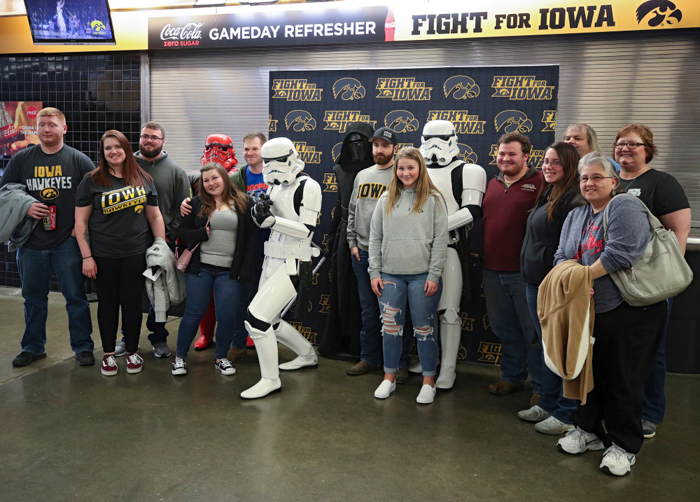Iowa Hawkeyes fan pose with Star Wars characters on the concourse before the game at Carver-Hawkeye Arena in Iowa City on Sunday, December 29, 2019. (Stephen Mally/hawkeyesports.com)