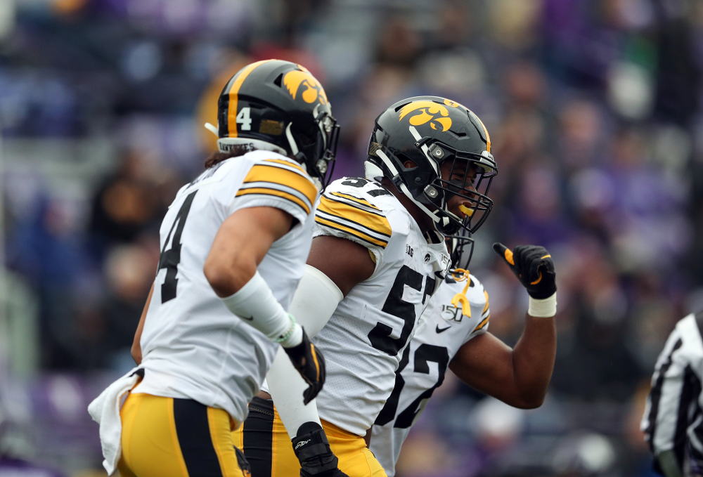 Iowa Hawkeyes defensive end Chauncey Golston (57) celebrates an interception against the Northwestern Wildcats Saturday, October 26, 2019 at Ryan Field in Evanston, Ill. (Brian Ray/hawkeyesports.com)