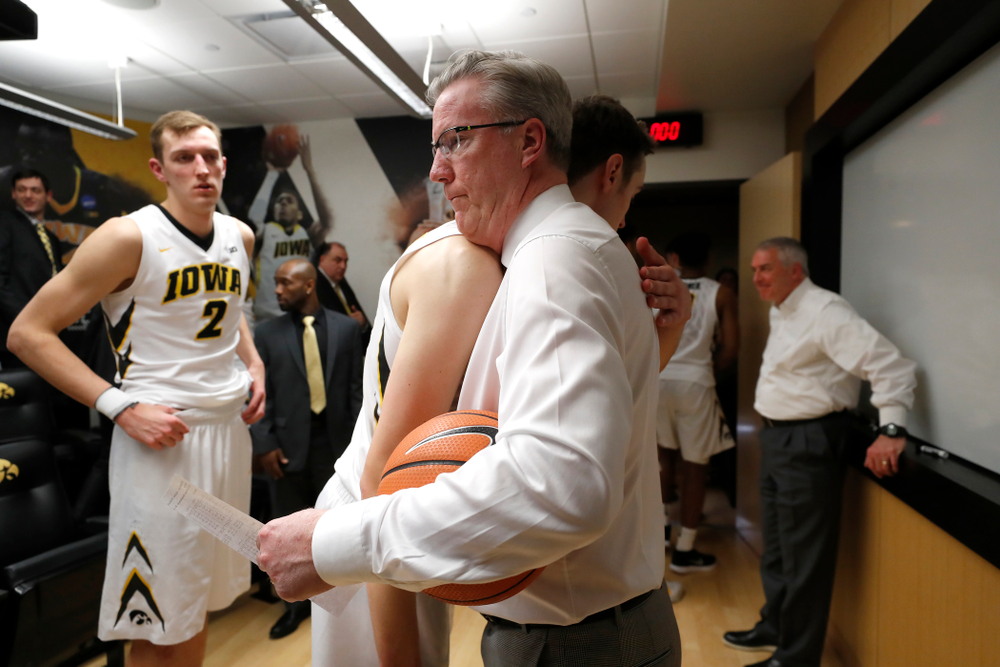 Iowa Hawkeyes head coach Fran McCaffery and forward Nicholas Baer (51)