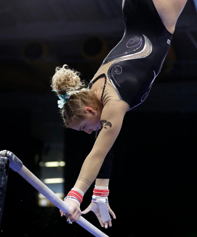 Iowa's Emma Hartzler competes on the bars against the Nebraska Cornhuskers