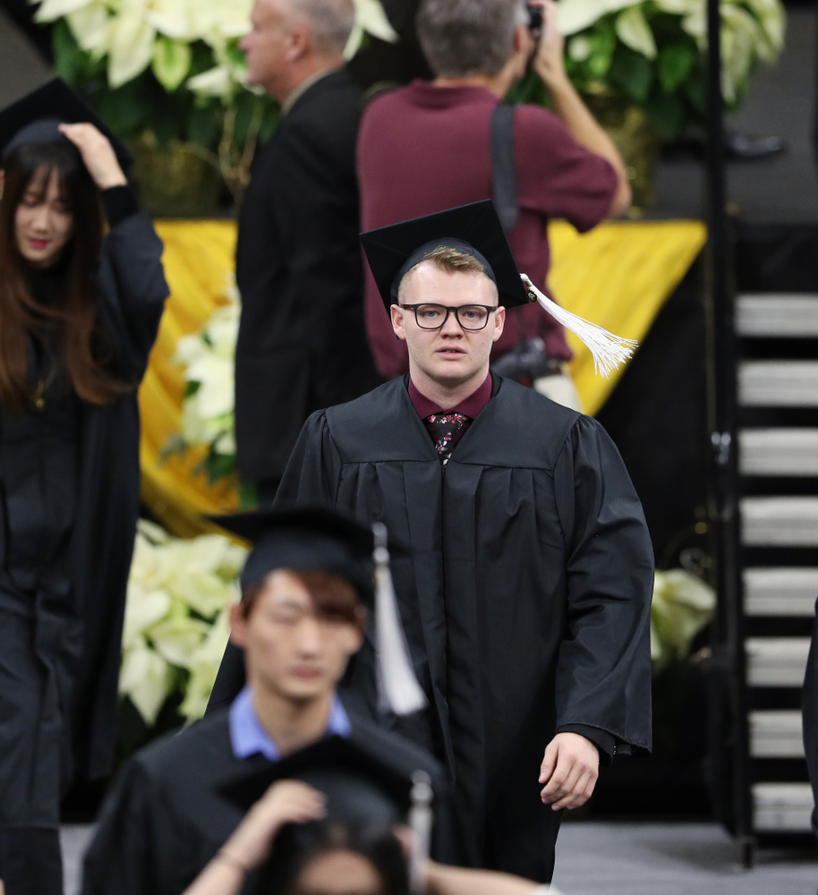 Iowa Men's Basketball manager Lucas Pauley during the Fall Commencement Ceremony  Saturday, December 15, 2018 at Carver-Hawkeye Arena. (Brian Ray/hawkeyesports.com)