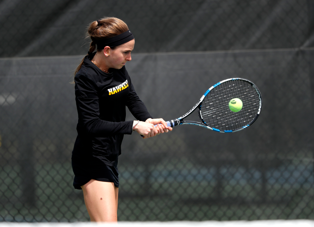 Iowa's Adrienne Jensen against the Wisconsin Badgers Sunday, April 22, 2018 at the Hawkeye Tennis and Recreation Center. (Brian Ray/hawkeyesports.com)