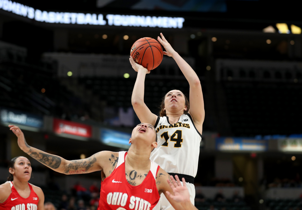Iowa Hawkeyes forward McKenna Warnock (14) against Ohio State in the quarterfinals of the Big Ten Basketball Tournament Friday, March 6, 2020 at Bankers Life Fieldhouse in Indianapolis. (Brian Ray/hawkeyesports.com)