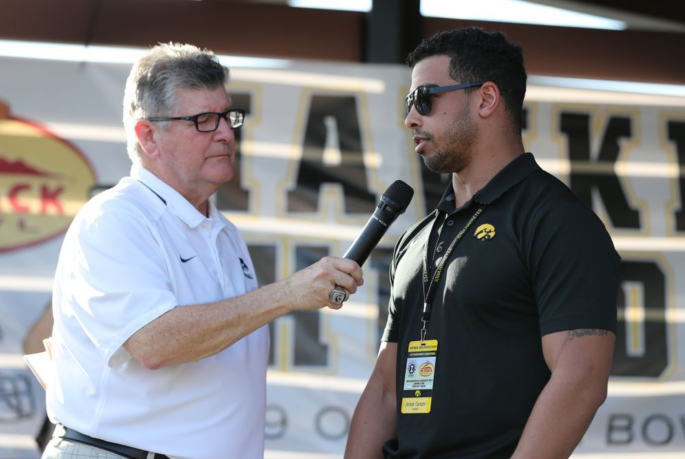 Voice of the Hawkeyes Gary Dolphin speaks with former Hawkeye Football running back Jordan Canzeri during the Hawkeye Huddle Monday, December 31, 2018 at Sparkman Wharf in Tampa, FL. (Brian Ray/hawkeyesports.com)