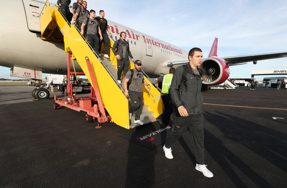 Iowa Hawkeyes quarterback Nate Stanley (4) disembarks the team plane Wednesday, December 26, 2018 as they arrive in Tampa, Florida for the Outback Bowl. (Brian Ray/hawkeyesports.com)