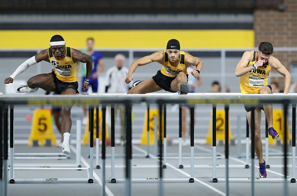 Iowa's Jaylan McConico (from left), Jamal Britt, and Josh Braverman run the men's 60 meter hurdles premier event during the Larry Wieczorek Invitational at the Recreation Building in Iowa City on Saturday, January 18, 2020. (Stephen Mally/hawkeyesports.com)