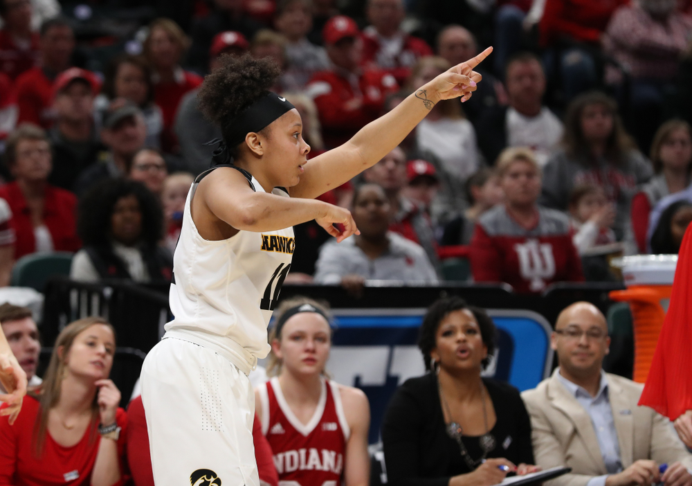 Iowa Hawkeyes guard Tania Davis (11) knocks down a three point basket against the Indiana Hoosiers in the quarterfinals of the Big Ten Tournament Friday, March 8, 2019 at Bankers Life Fieldhouse in Indianapolis, Ind. (Brian Ray/hawkeyesports.com)