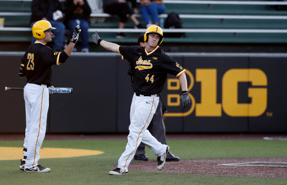 Iowa Hawkeyes outfielder Robert Neustrom (44) and infielder Kyle Crowl (23) against Milwaukee Wednesday, April 25, 2018 at Duane Banks Field. (Brian Ray/hawkeyesports.com)
