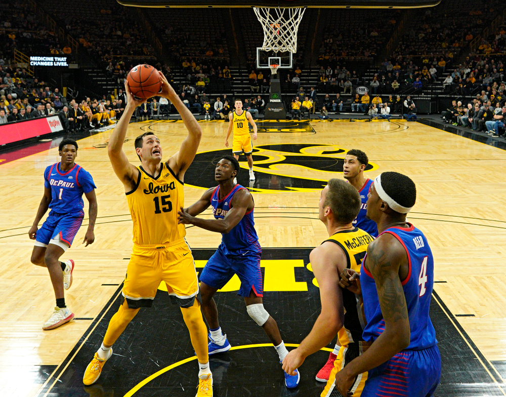 Iowa Hawkeyes forward Ryan Kriener (15) scores a basket inside during the first half of their game at Carver-Hawkeye Arena in Iowa City on Monday, Nov 11, 2019. (Stephen Mally/hawkeyesports.com)